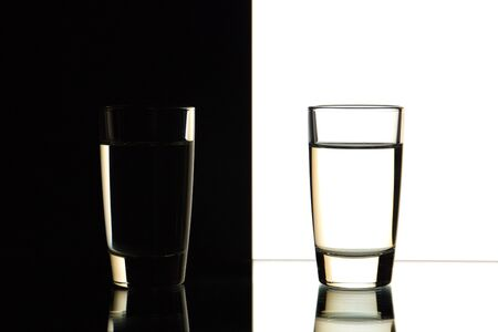 sulphide: two glasses are isolated on a black and white background