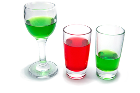 sulphide: Glass with a colored liquid is isolated on a white background Stock Photo