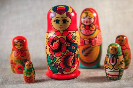 muñecas rusas: Russian dolls. Matryoshka on linen fabric for the background.