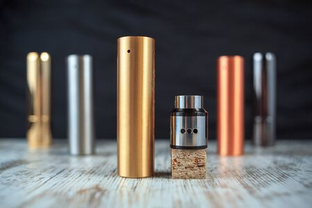 Electronic cigarette and liquid tank on the table. Mechanical mod. ENDS. Stock Photo