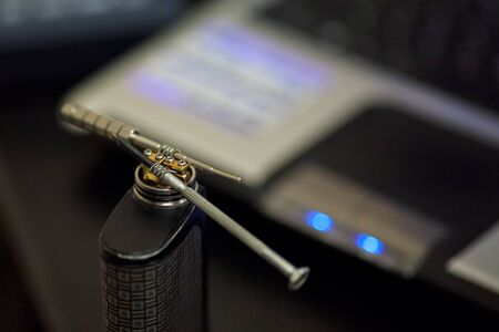 Vape after-sales service of the e-cigarette. Regulating of electronic cigarette coils. Personal vaporizer. Close up.