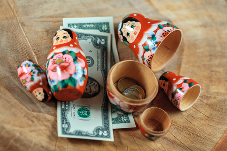 Matryoshka. Russian doll with dollars. Anti crisis money box. Matrioska bank.