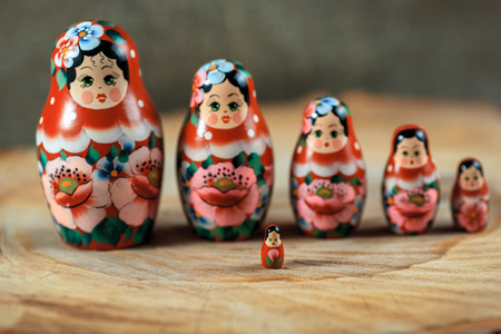 Matryoshka family. Russian doll on a wooden table. Matrioska art.
