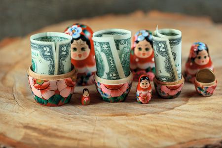 disclosure: Russian doll with dollars inside. Anti crisis money box. Matrioska bank.