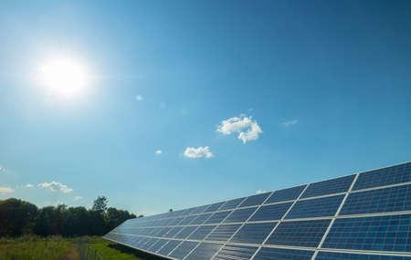 rural landscape, solar panel and sun photo