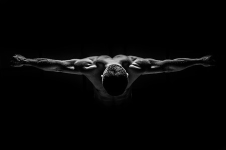 leaned: Strong man leaned forward and placed her hands BW