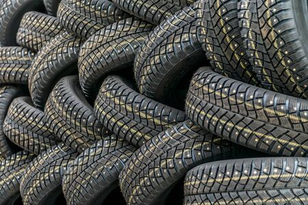 winter tires: Background with winter tires with spikes Stock Photo