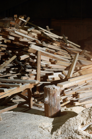 lumber room: Lumber lay in the room next to the chip and stump