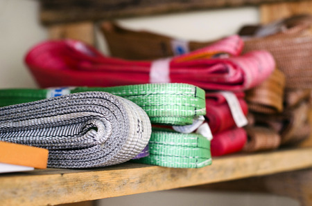 slings: Colored slings operating procedures for heavy loads are on the rack Stock Photo