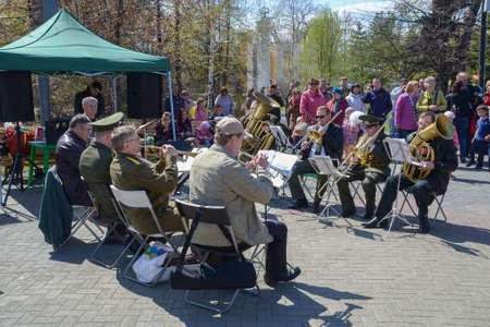 Chelyabinsk Russia may 9 2014 a brass band plays a waltz on a dance floor in a Park