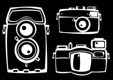 set of three vintage film photo cameras isolated on black background photo