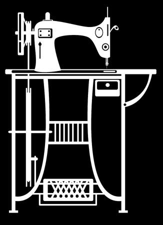 sewing machine on black background photo