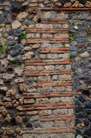 imbedded: Part of ancient brick wall on the excavations at Pompeii Stock Photo