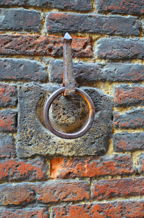 imbedded: Brick wall in Pompeii with a ring Stock Photo