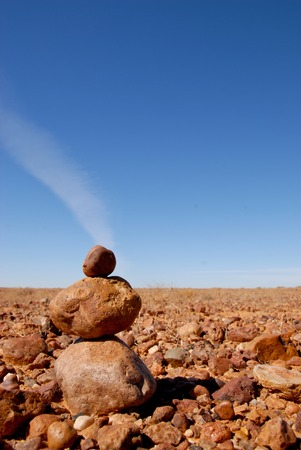 torridity: Stoneman in Australian stone desert on a background of blue blue sky