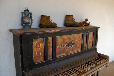 kerosene lamp: Kerosene lamp and boots on an old piano in Kings Canyon in Australia near