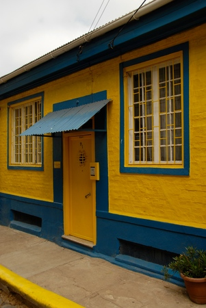 lodger: Entrance to the yellow-blue house with two windows