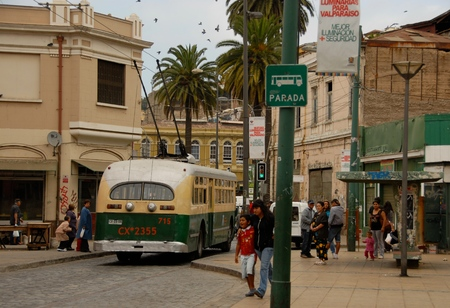 small town life: People gathered at the bus stop waiting for the old trolley