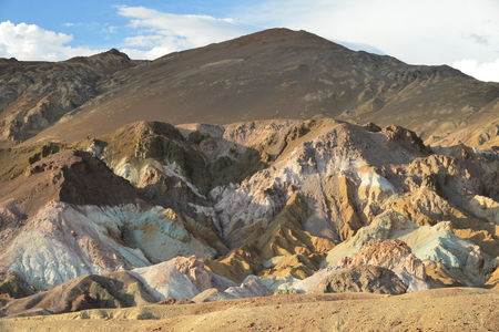 lithic: Stone brown peaks directed to the blue sky among the hot desert Stock Photo