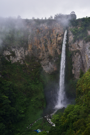 indonesian biodiversity: Waterfall Sipisopiso height of 120 meters on the shore of Lake Toba is surrounded by green trees (Sumatra, Indonesia)