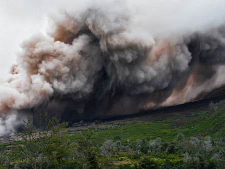 indonesian biodiversity: Thick smoke and ash from the volcano Sinabung is spread along the side of the mountain (Sumatra, Indonesia)