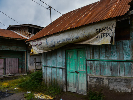 indonesian biodiversity: Wooden abandoned houses on the island are, after evacuation of the volcano (Sumatra, Indonesia)