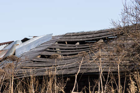 unsound: Old barn with a broken roof. Russian reality, they live far from the capital