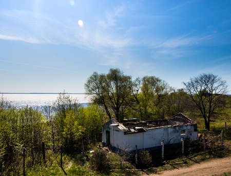 The dilapidated building on the background of the Gulf of Finland in the fort Constantine Stock Photo