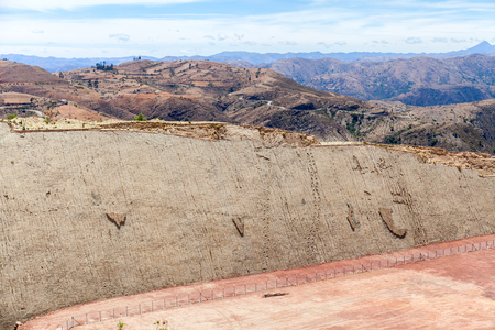 Real dinosaur footprint imprinted in the rock. Side view. Nacional Park in Sucre, Bolivia