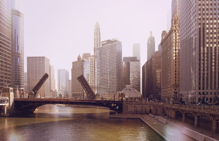 The raising of the bridge on the Chicago River and sailboats move from their harbor on Lake Michigan. vintage photo effect Banque d'images