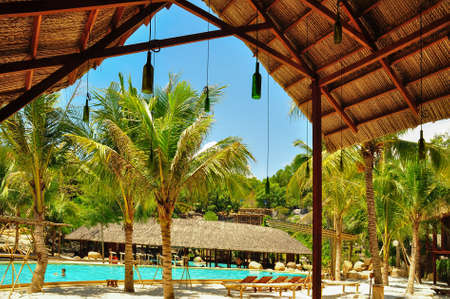 View of the pool in the park under the cane roof. Banco de Imagens