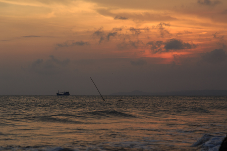fishing boat to the sea at sunset Stock Photo