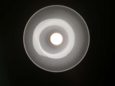 power projection: the lamp in the luminaire, viewed from the bottom on a black background