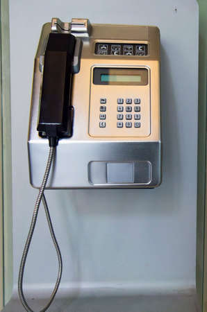 payphone: Public telephone on the wall