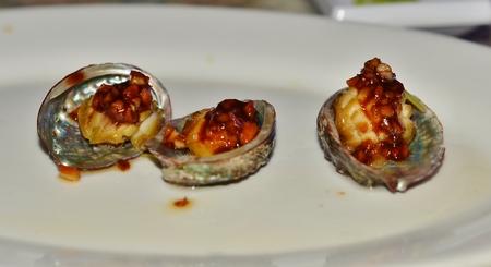 molluscs: Molluscs Abalon garlic sauce Stock Photo