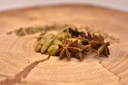 Star anise green cardamom and fennel seeds to cut down a tree with a crack. Stock Photo