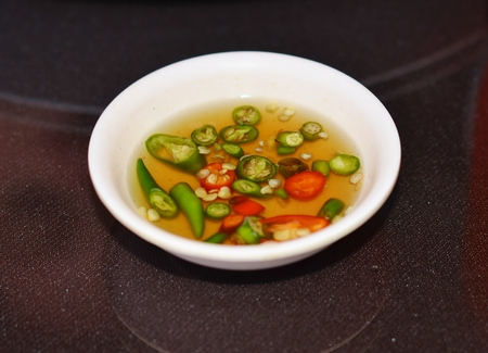 plates of food: Spicy Thai sauce for fried rice with red and green chilies Stock Photo