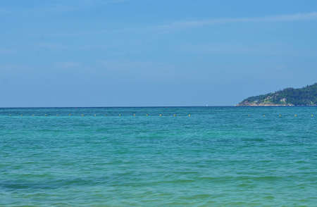 tri: View of the sea, sky and mountains overgrown with jungle Tri Trang Beach in Phuket Stock Photo