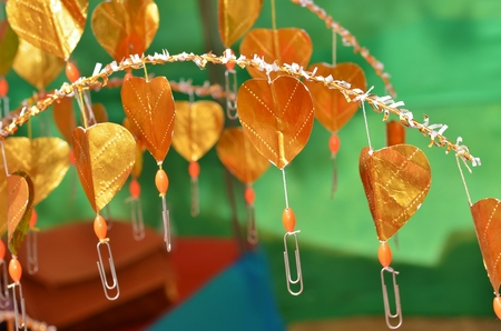 paper clips: Buddhist golden money tree with hearts instead of leaves and paper clips for banknotes, Thailand