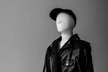 Mannequin in a leather jacket and cap