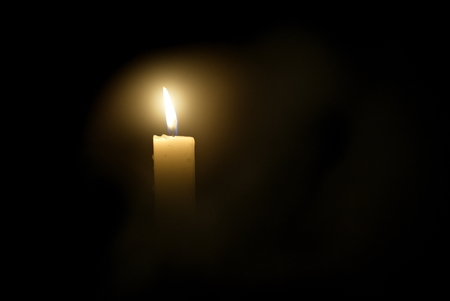 Candle in the dark. Candle in the dark in dimu Stock Photo
