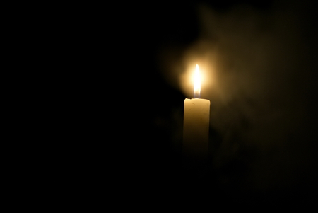Candle in the dark. Candle in the dark in dimu 스톡 콘텐츠
