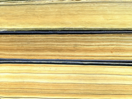 Pages of an old yellowed book Фото со стока
