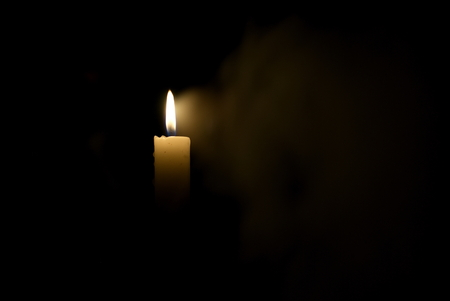 Candle in the dark. Stock Photo