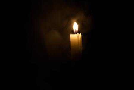 Candle in the dark. Candle in the fog. Candle in the dark in dimu