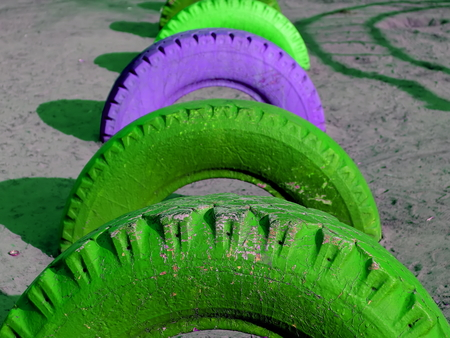 Old colored tires buried. Painted old car tires Stock fotó