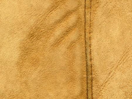 Rote oder braune Textur aus Leder oder Wildleder. Standard-Bild