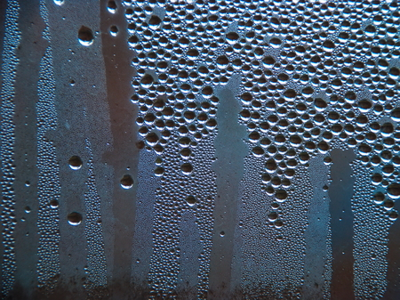 Drops of water on a cold glass. Condensate on glass Standard-Bild