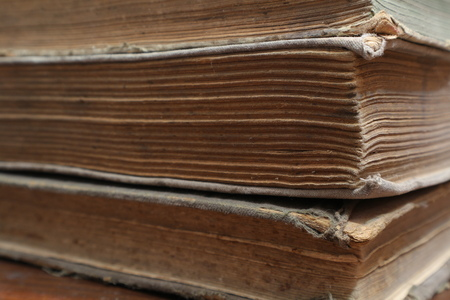 Yellowed pages of the old dilapidated book. Old book. Folio. Yellowed from old age book Reklamní fotografie