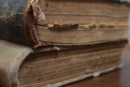 Yellowed pages of the old dilapidated book. Old book. Folio. Yellowed from old age book Stock fotó